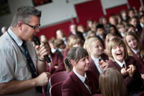 Pupils laughing at The Reading Skills Show.