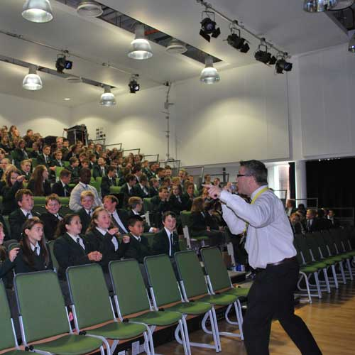 An audience of pupils joining in with The Punctuation Show.